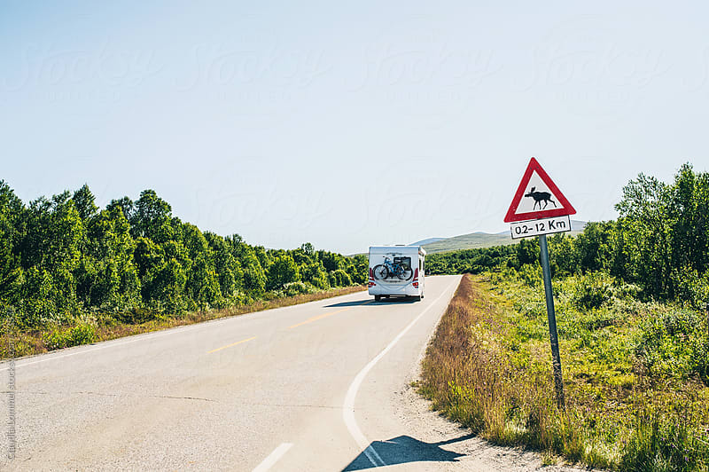 Caravan on Highway with a Moose Warning Sign  in Norway, Scandinavia by Claudia Lommel for Stocksy United