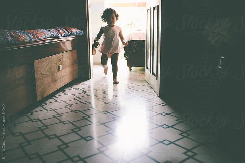 Toddler running into the room by Saptak Ganguly for Stocksy United