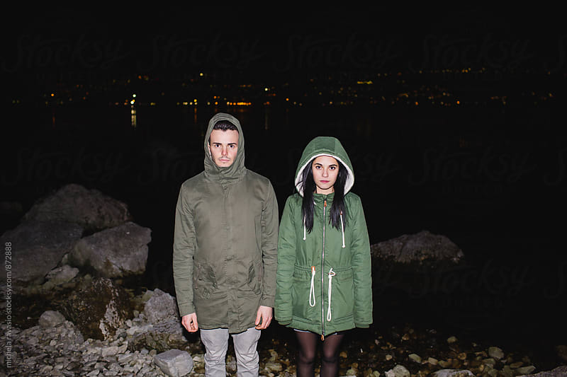 Teenage couple on the lake at night by michela ravasio for Stocksy United
