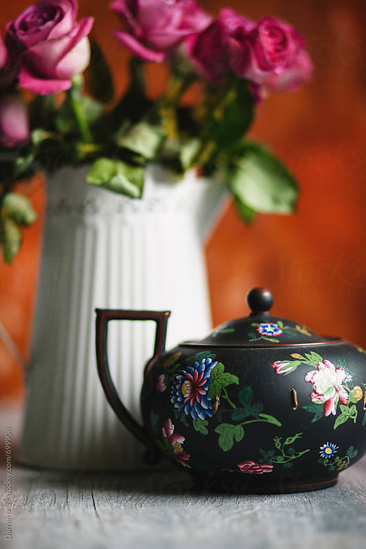 A teapot and some flowers on a table. by Darren Muir for Stocksy United