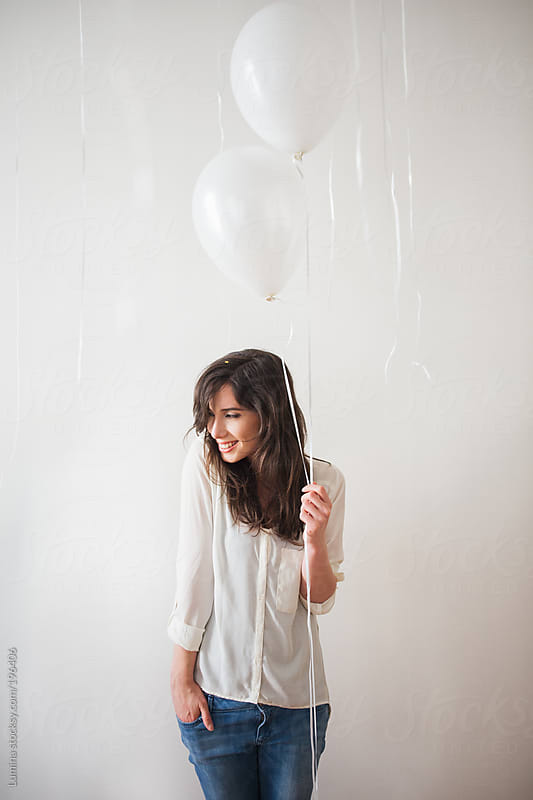 Pretty Woman With White Balloons by Lumina for Stocksy United