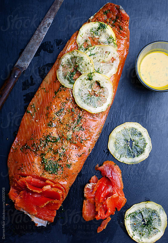 Home cured salmon. A side of cured salmon on a slate. by Darren Muir for Stocksy United