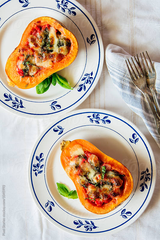 Summer vegetable-stuffed butternut squash by Pixel Stories for Stocksy United