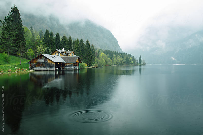 Idyllic foggy landscape with houses on riverside by Andrey Pavlov for Stocksy United