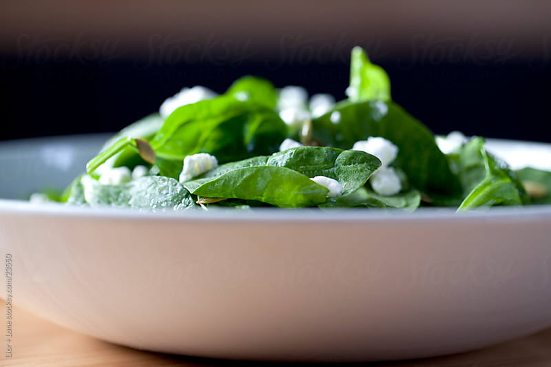 Spinach and feta salad by Lior + Lone for Stocksy United