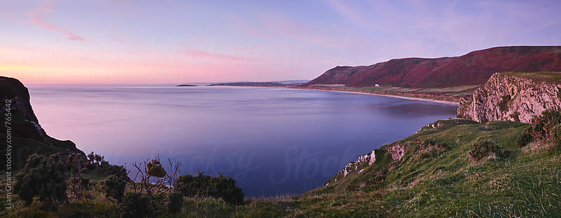 Rhossili beach at twilight. Wales, UK. by Liam Grant for Stocksy United