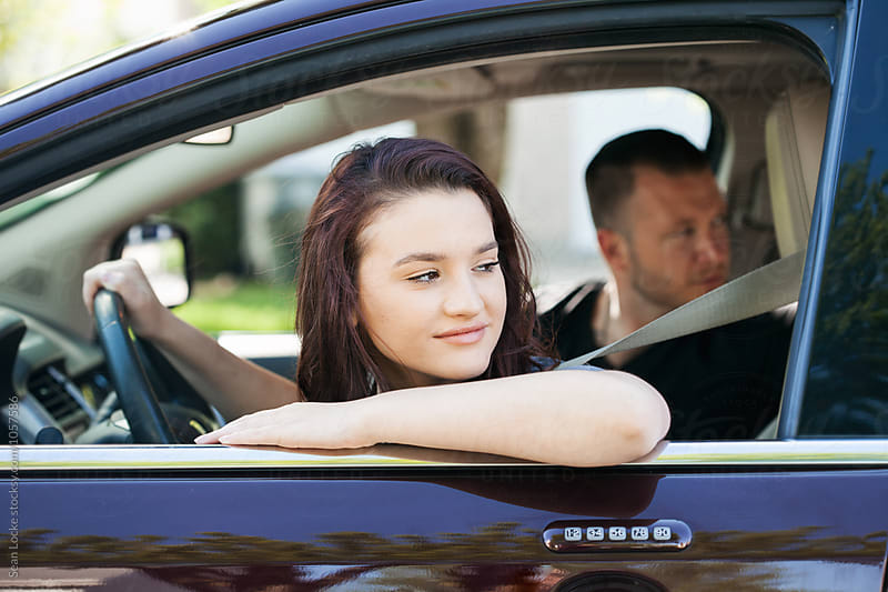 Driving: Teen Girl Driving In Reverse by Sean Locke for Stocksy United