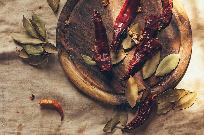 Chili on a wooden cutting board. by Marija Savic for Stocksy United