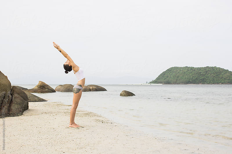 Woman Doing Yoga at the Beach by Mosuno for Stocksy United