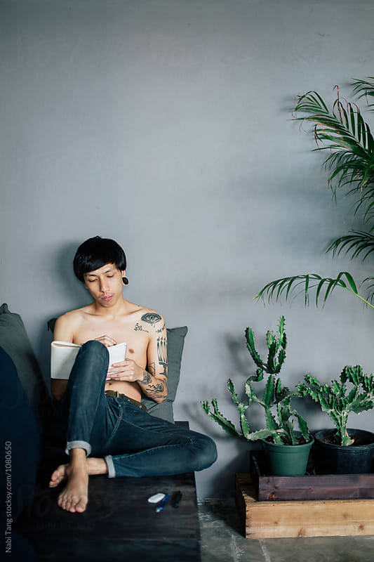 Asian alternative young man working at home by Nabi Tang for Stocksy United
