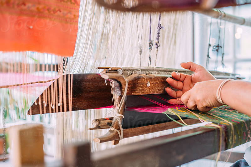 Hands of a woman weaving on a loom by Jovo Jovanovic for Stocksy United