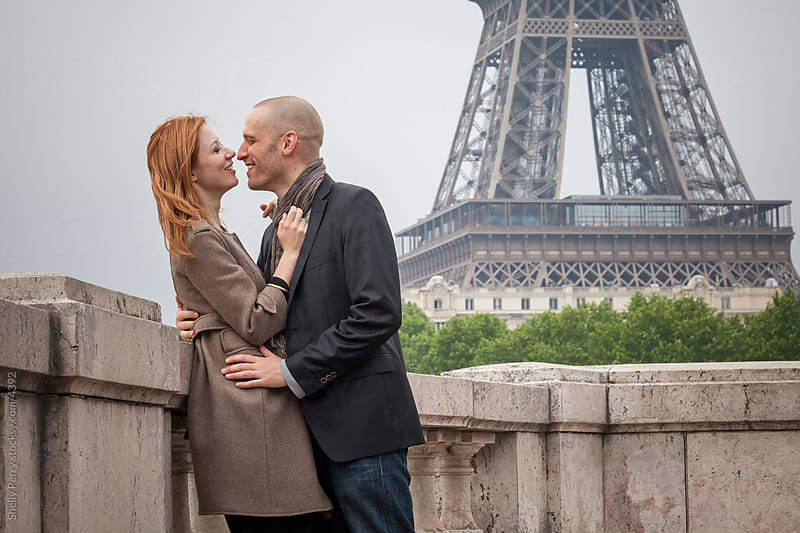 Romantic couple in Paris embrace near the Eiffel Tower by Shelly Perry for Stocksy United