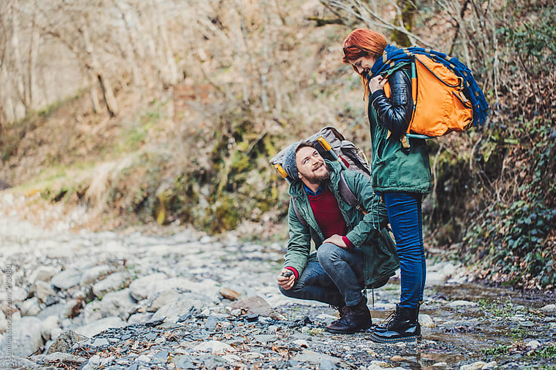 Couple Hiking With a Backpack by Lumina for Stocksy United