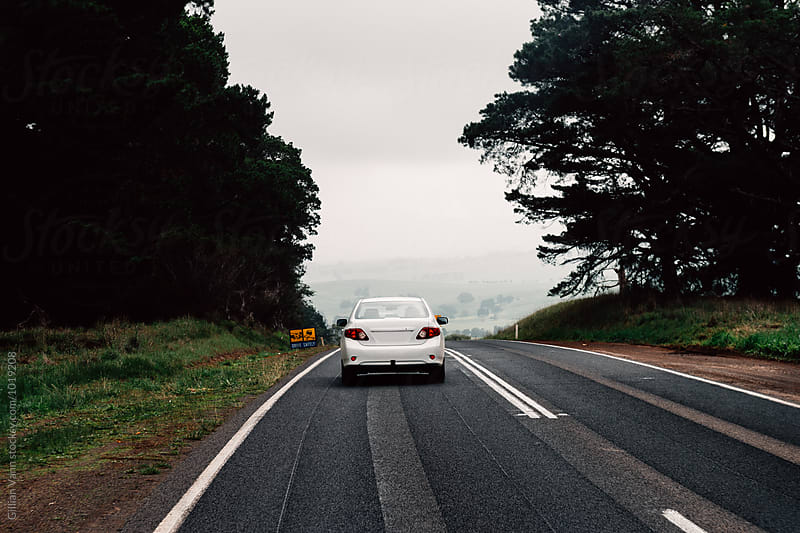 white car in the country in rural Victoria, Australia by Gillian Vann for Stocksy United