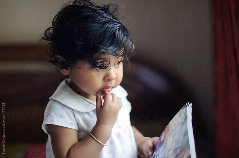 Baby girl in deep thought by Saptak Ganguly for Stocksy United