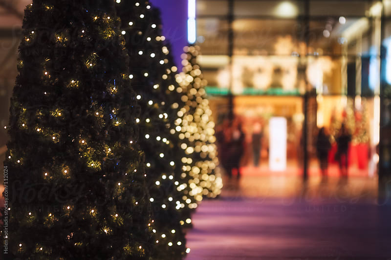 Christmas Trees Outside a Building by Helen Sotiriadis for Stocksy United