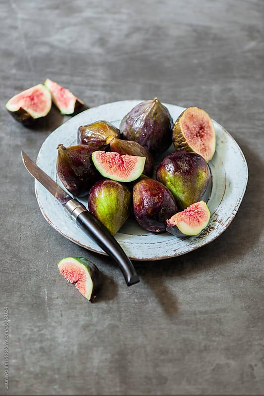 Purple figs by Laura Adani for Stocksy United