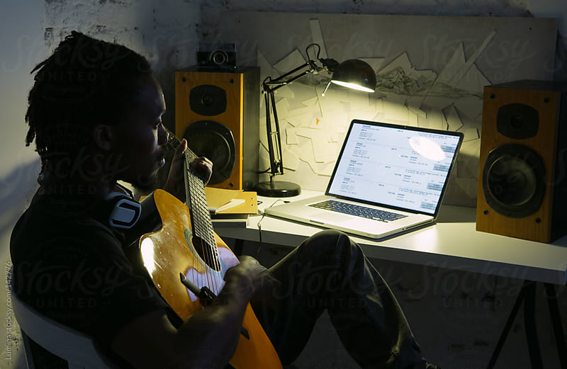 African Man Playing the Guitar by Lumina for Stocksy United