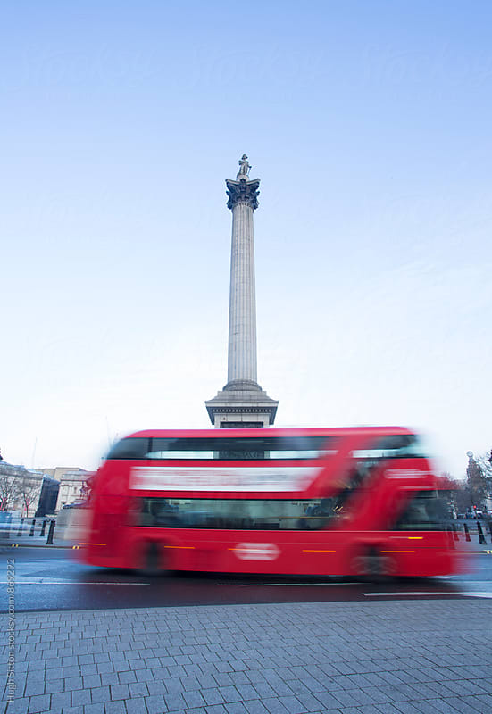 Bus passing Nelson's Column. Trafalgar Square. London. by Hugh Sitton for Stocksy United