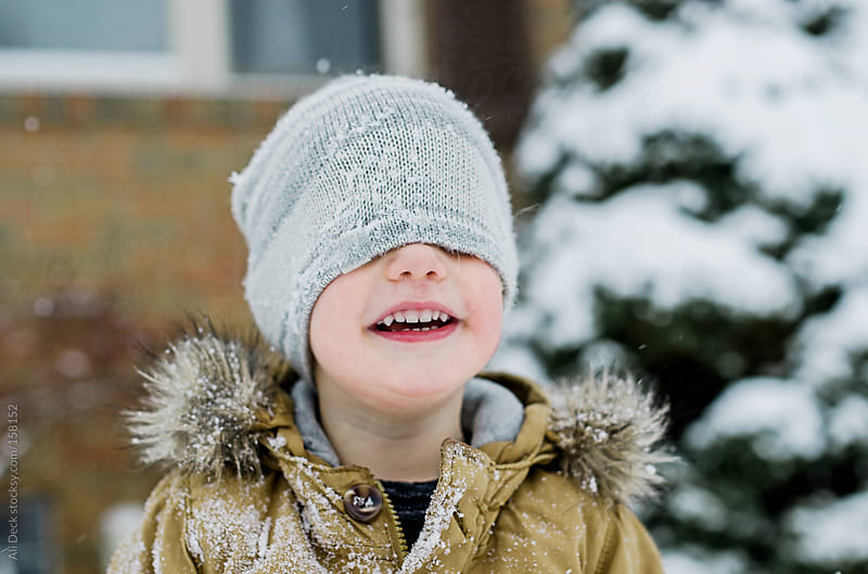 Toddler with Snowy Hat by Ali Deck for Stocksy United