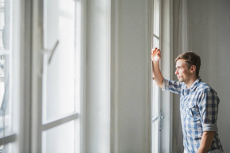 Man Standing by the Window by Lumina for Stocksy United