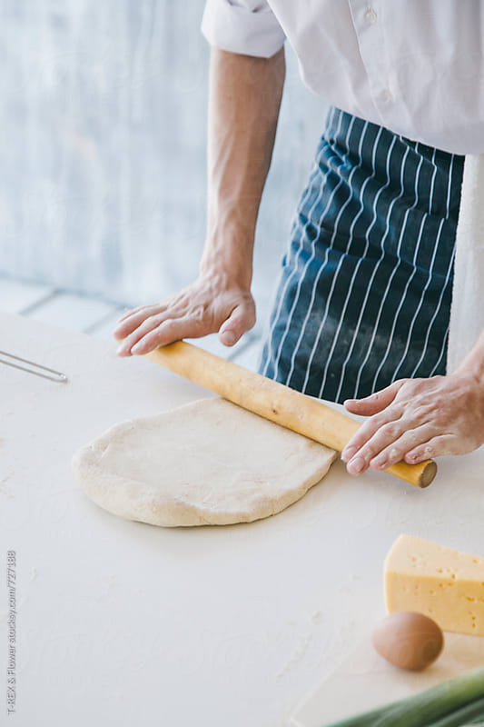 Chef kneads dough by Danil Nevsky for Stocksy United