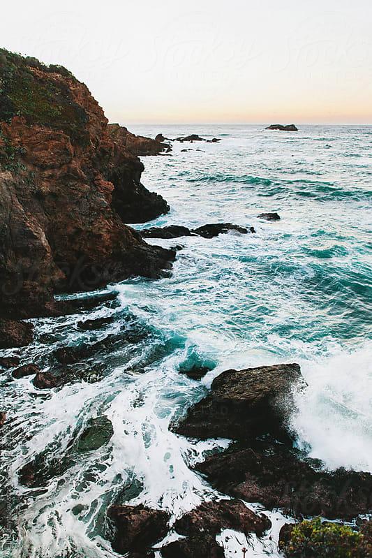 Monterey beach at sunset by Ellie Baygulov for Stocksy United