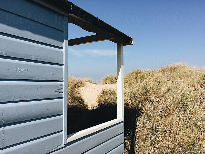 Beach huts among the sand dunes at Old Hunstanton, Norfolk, UK. by Liam Grant for Stocksy United