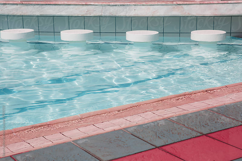 Abstract photo of some details of an empty swimming pool edge by Beatrix Boros for Stocksy United
