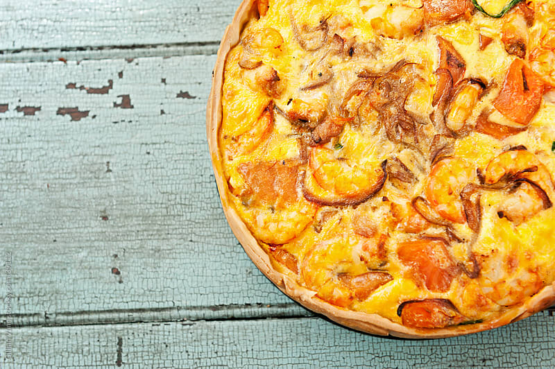 shrimp quiche, top down view by Gillian Vann for Stocksy United