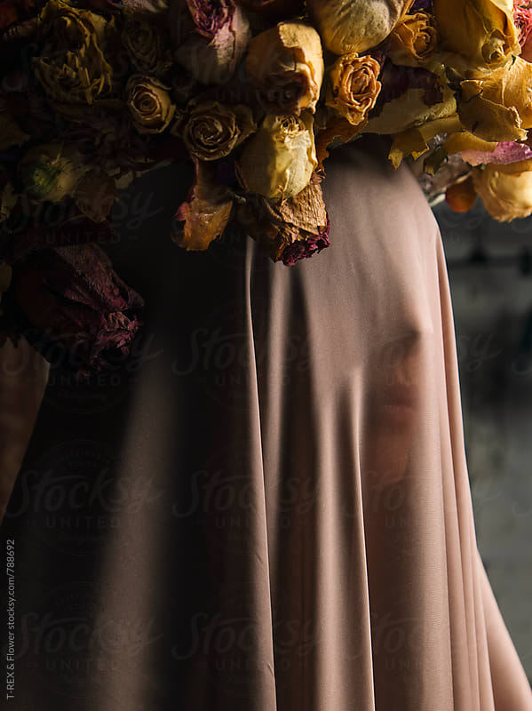 Woman under veil wearing wreath made of dried flowers by Danil Nevsky for Stocksy United