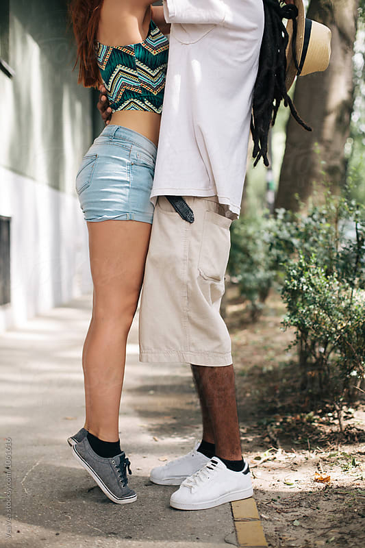 Couple hugging in the street by VeaVea for Stocksy United