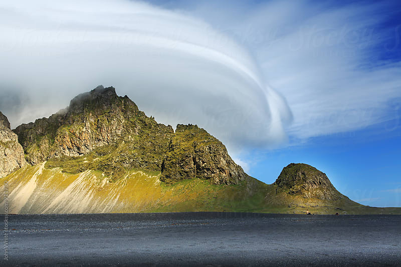 A mountain and black beach. Iceland. by John White for Stocksy United