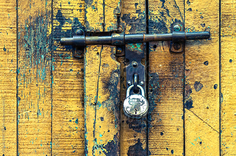 Old Yellow Door with Old Lock by VISUALSPECTRUM for Stocksy United
