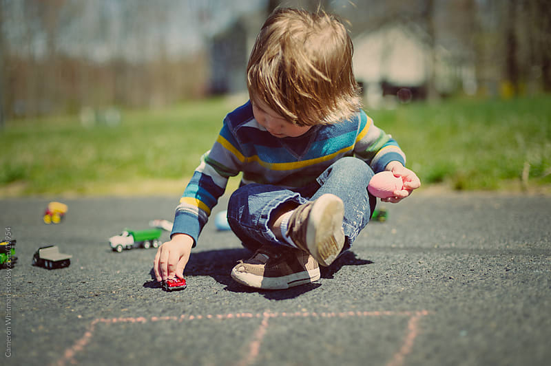 Toy Cars and Sidewalk Chalk  by Cameron Whitman for Stocksy United