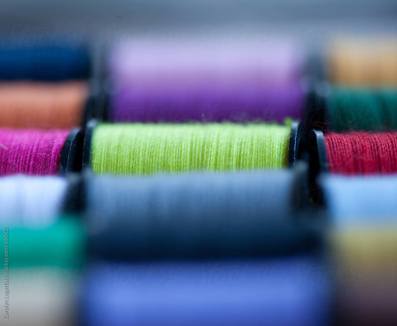 Several spools of colorful thread by Carolyn Lagattuta for Stocksy United