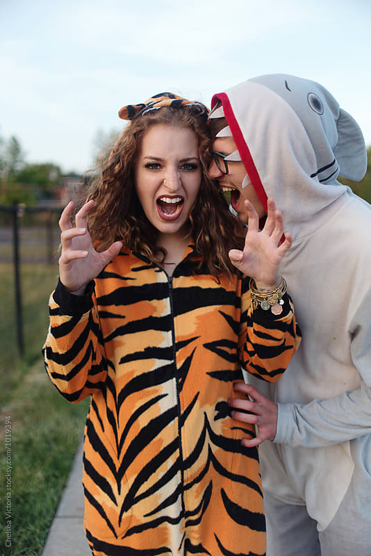A young couple wearing animal onesies by Chelsea Victoria for Stocksy United