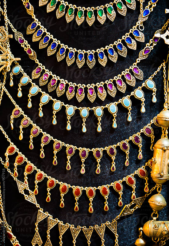 Necklaces at market in Morocco by Alejandro Moreno de Carlos for Stocksy United