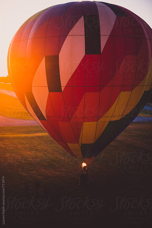 View of hot air balloon taking off by Lauren Naefe for Stocksy United