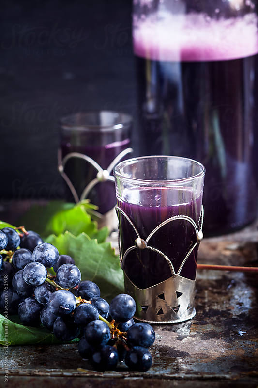 Grape juice by Susan Brooks-Dammann for Stocksy United