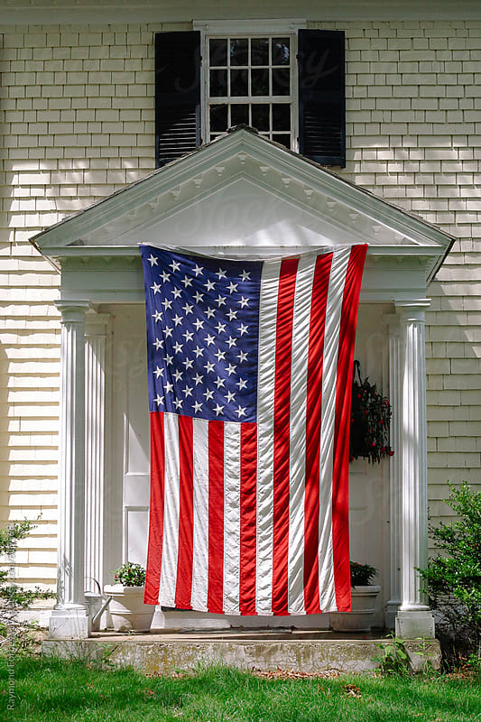 American Flag on Porch at 4th of July Celebration by Raymond Forbes LLC for Stocksy United