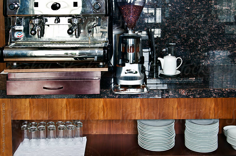 Machine for espresso with set of white plates and set of glasses by Marija Anicic for Stocksy United
