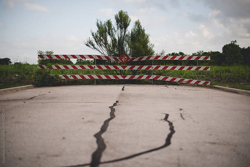 a crack in the road by Courtney Rust for Stocksy United