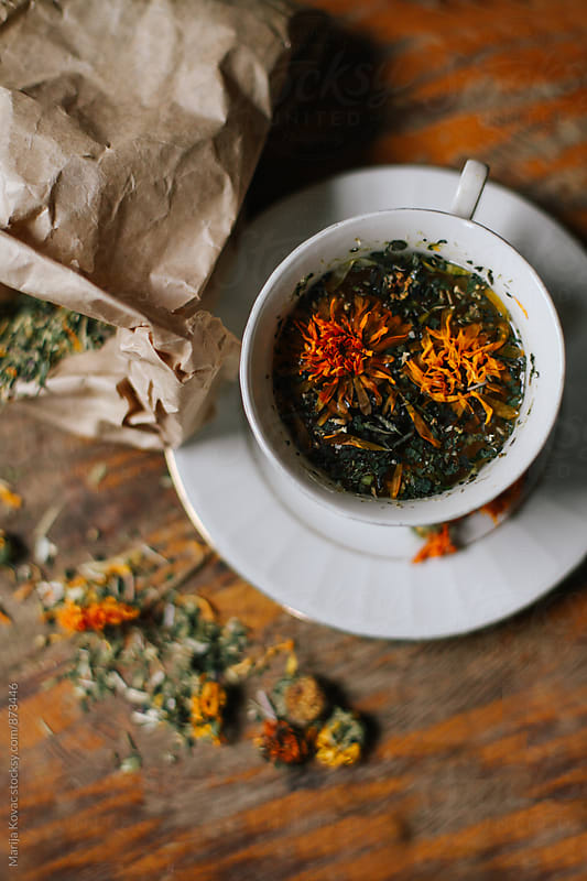 Mixed herbs tea from above  by Marija Kovac for Stocksy United