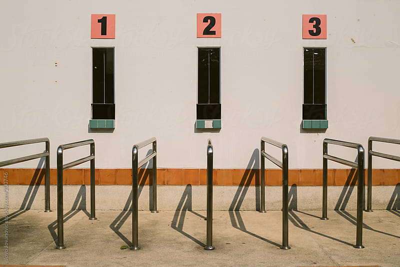 Ticket sales counter on a small stadium  by Jovo Jovanovic for Stocksy United
