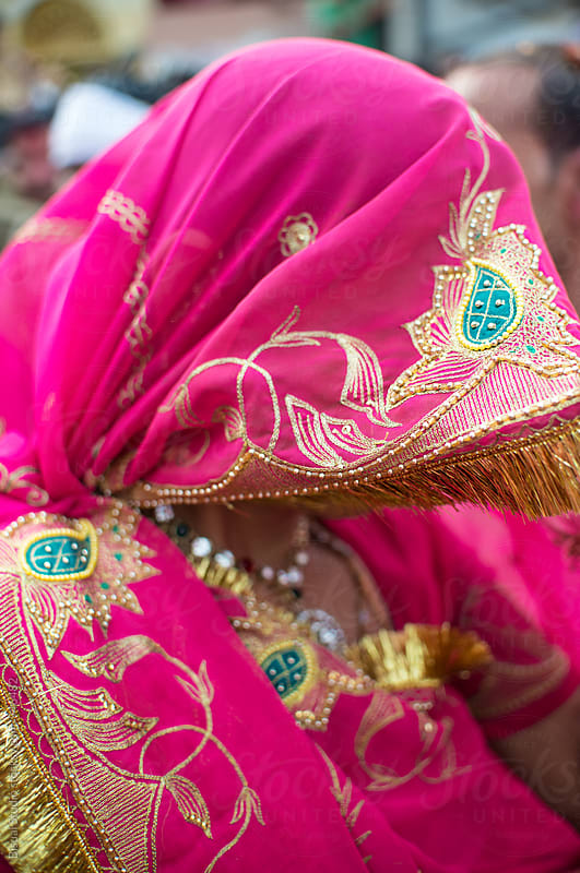 Rajasthani woman covering her face with a sari by Bisual Studio for Stocksy United