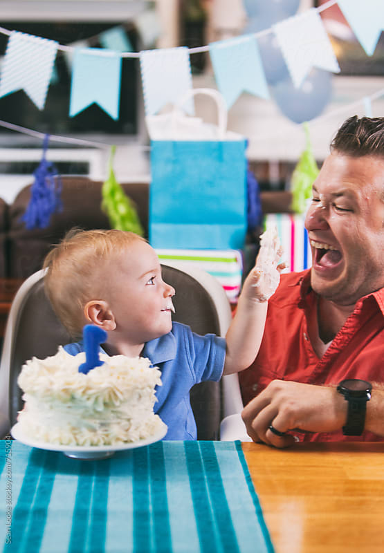 Birthday: Toddler Boy Puts Icing On Father's Face by Sean Locke for Stocksy United