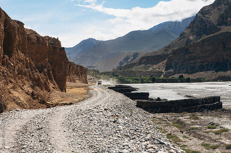 Four-wheel drive on the dry and desolate landscape of Upper Mustang. by Shikhar Bhattarai for Stocksy United