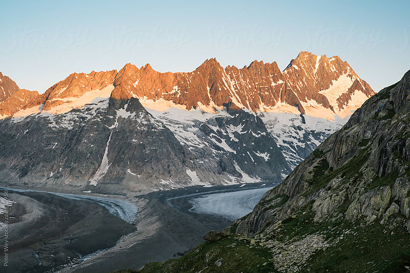 Lauteraarhorn mountain peak with Unteraar glacier at sunrise by Peter Wey for Stocksy United