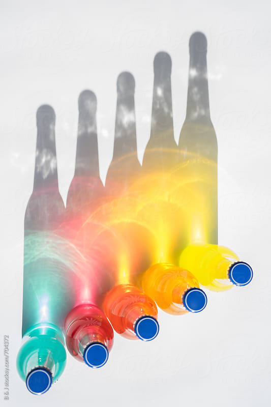Colorful rainbow bottles by B & J for Stocksy United